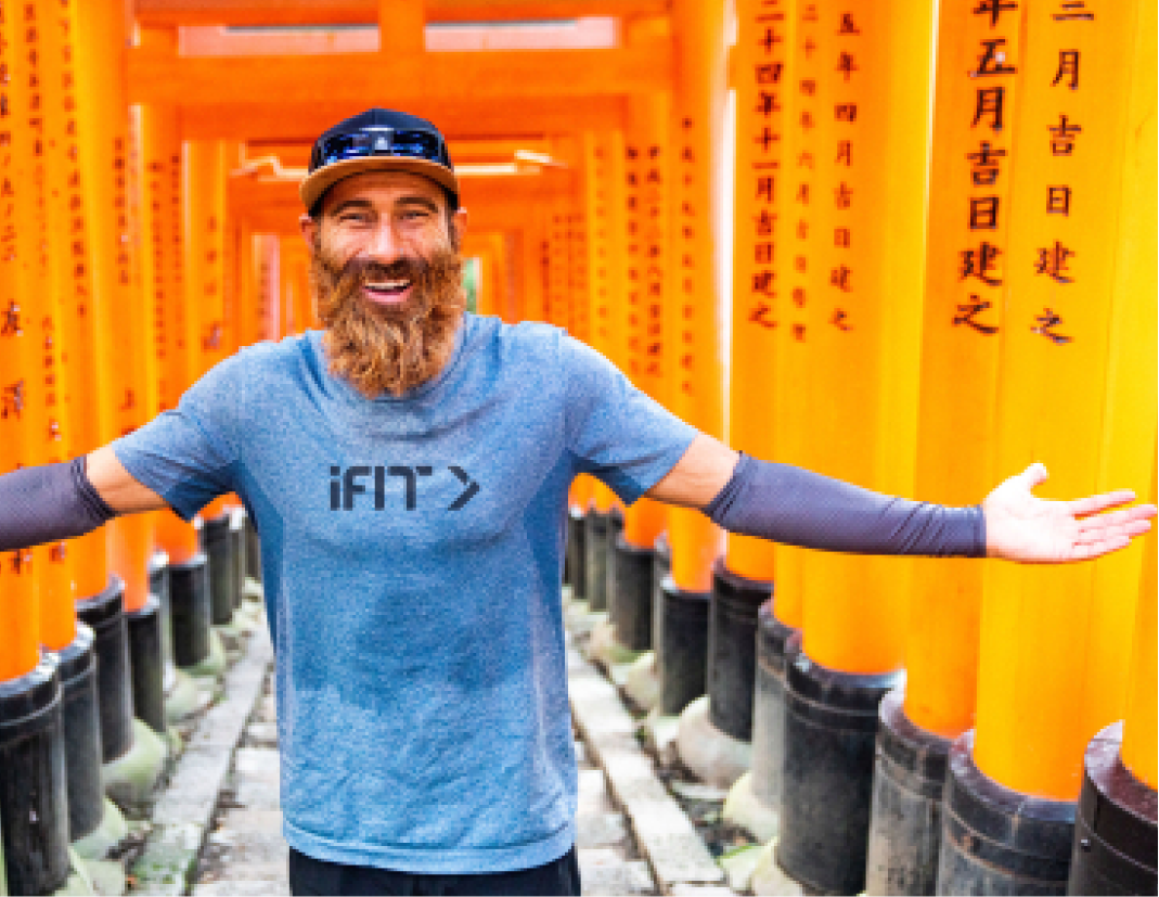 Personal trainer coaches an iFIT running class