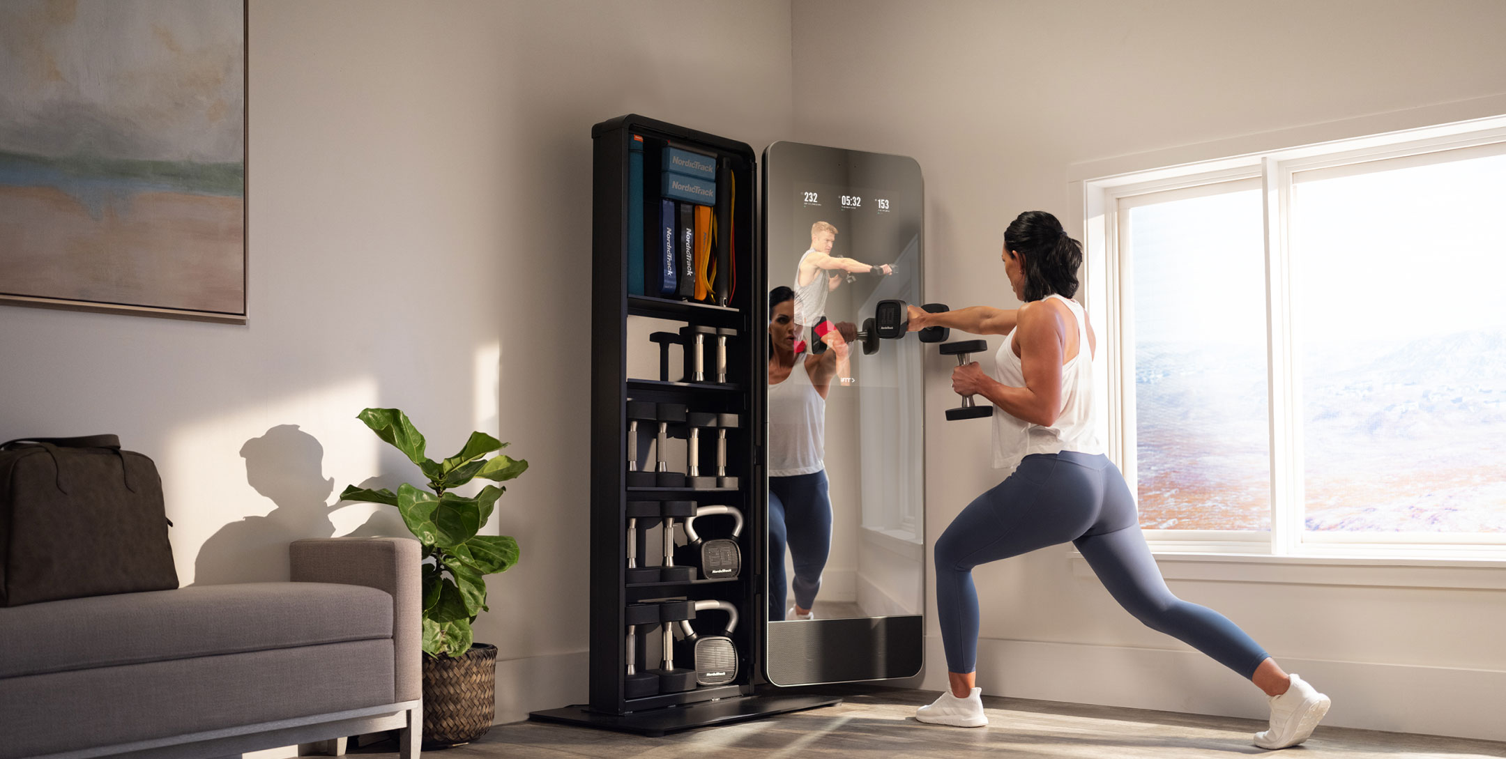 Woman exercises in front of a fitness mirror in living room