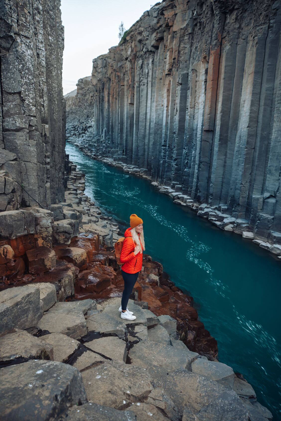 Ása Steinars standing in Studlagil canyon, located in the East of Iceland