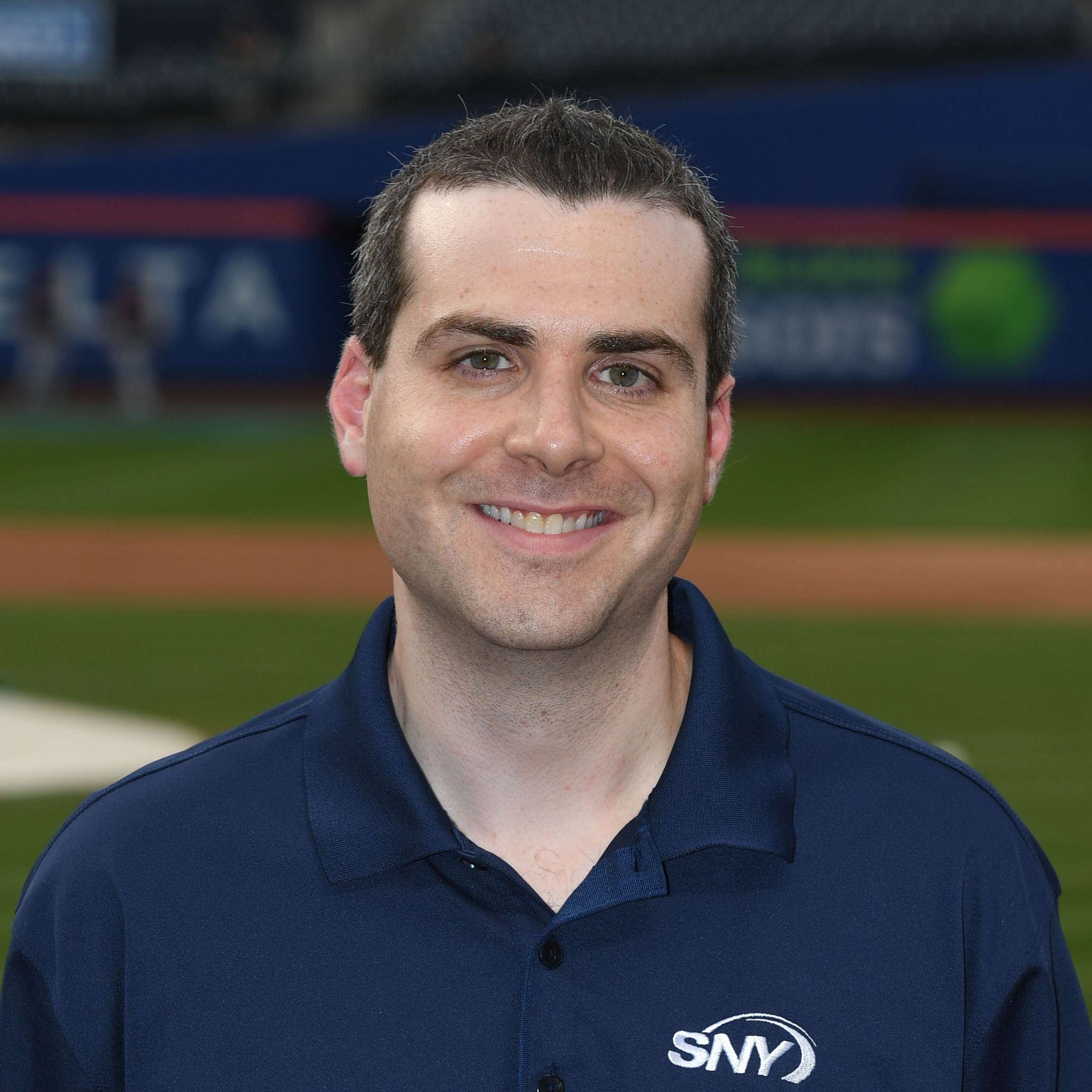 "Steve Gelbs is SNY's Mets Field Reporter. Gelbs joined Gary Cohen, Keith Hernandez and Ron Darling in 2015 as member of the network's Emmy Award winning Mets broadcast team. He joined SNY in 2013 as an anchor and sport reporter contributing to the network's sports and entertainment shows. He is also a regular contributor to SNY's Mets pre-and post-game shows, Baseball Night in New York and Mets Hot Stove.  Prior to joining SNY, Steve spent a year and a half at MSG Network, as well as four years at MSG Varsity in New York. On the TV side at MSG Network, Steve served as a host of the ""MSG 150"" during Knicks and Rangers telecasts, as well as a host for the network's College Basketball coverage. On MSG Radio Network, Steve handled the pre-game, post-game and intermission reports for Rangers Broadcasts - which aired on ESPN Radio in New York. In his four years at MSG Varsity, Steve was utilized in a number of different capacities. He was an anchor, host, feature & sideline reporter, play-by-play announcer and color commentator. While at MSG Varsity, Steve was nominated for 4 New York Emmys, including ""Sports Anchor of the Year"" in 2012.  Steve graduated Syracuse University's Newhouse School of Public Communications in 2009, with a bachelor's degree in Broadcast Journalism. He won the Syracuse Press Club Award for ""Best Radio Sports Feature,"" in 2009."