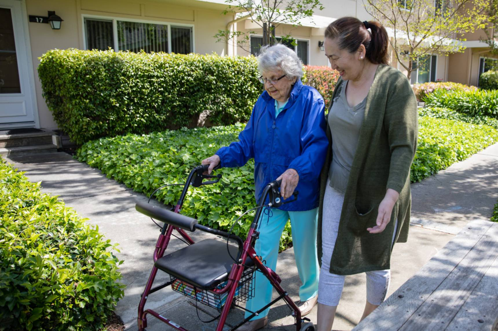 Caregiver walking with elder client