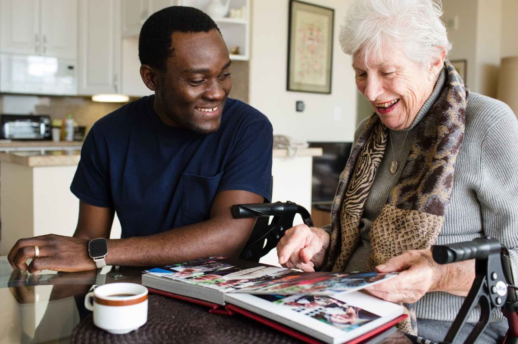 caregiver and client looking at a photo album