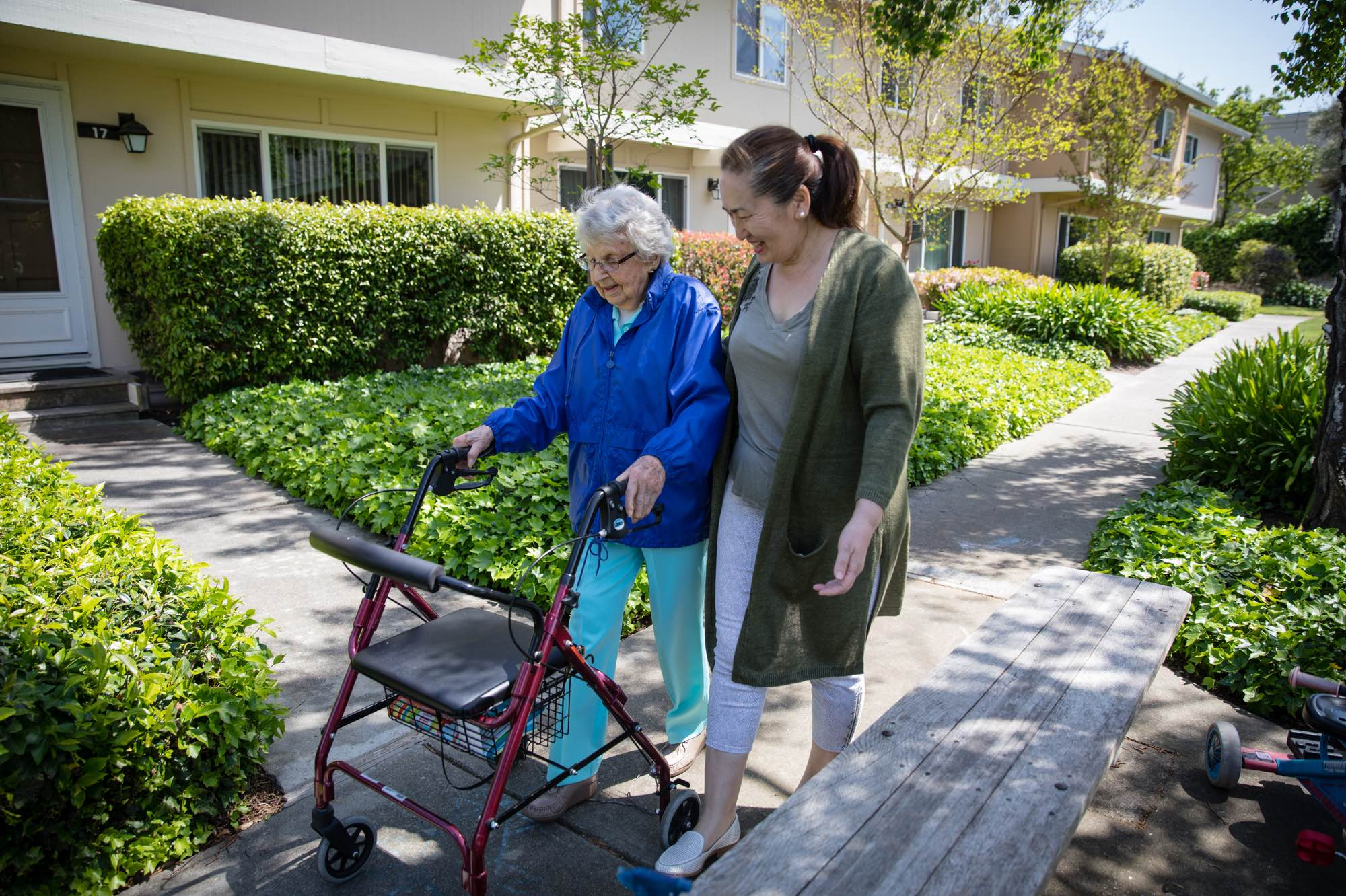 An Honor Care Pro caregiver walking with client with a walker