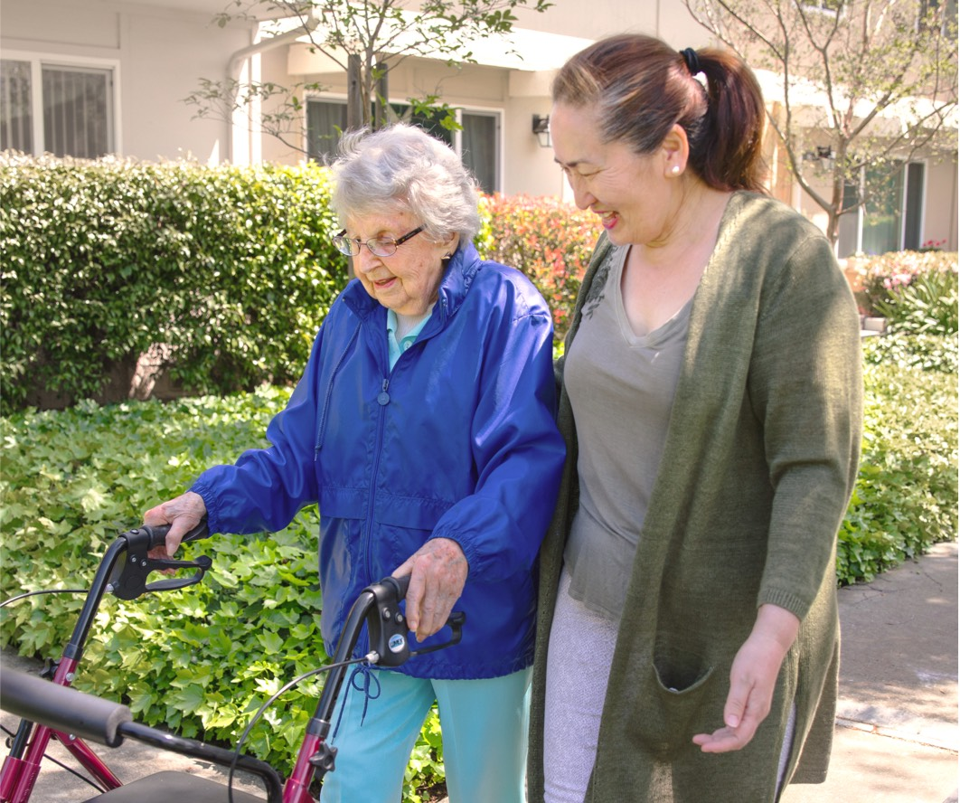 Care Pro walking with elderly client.