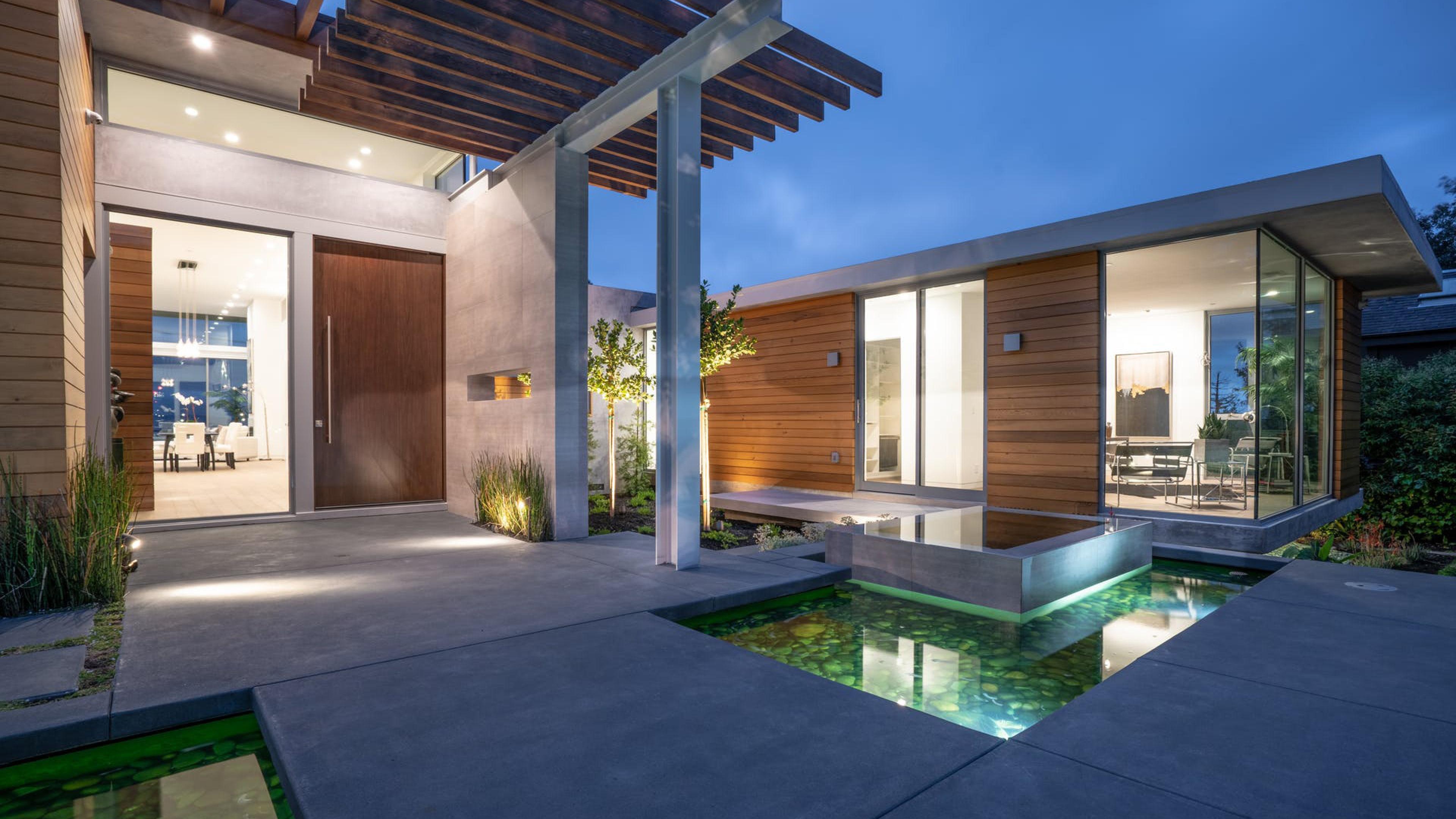 custom home exterior courtyard floor to ceiling aluminum windows and doors
