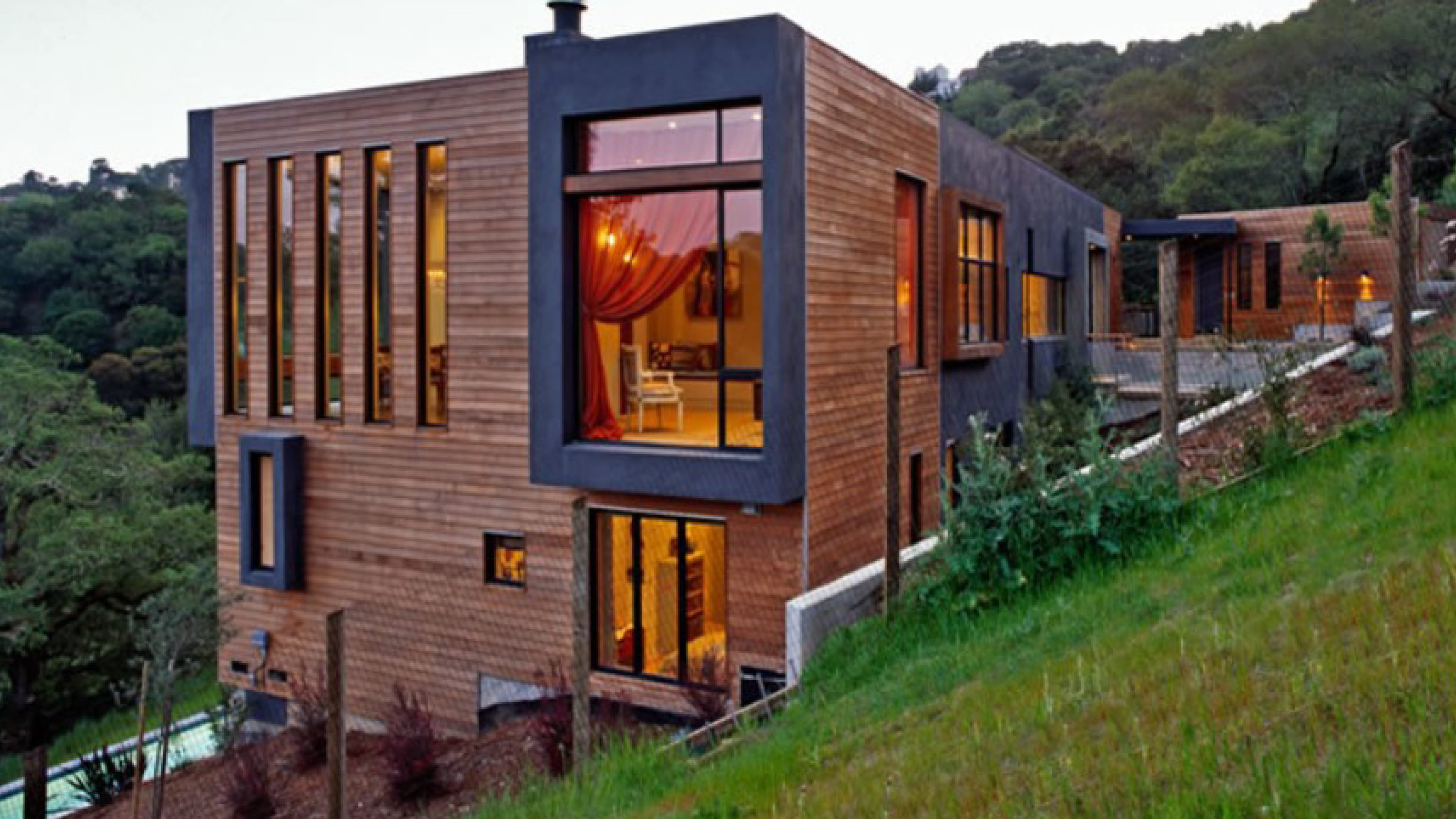 sleepy hollow home on a hill with dramatic extended black sills around custom aluminum windows