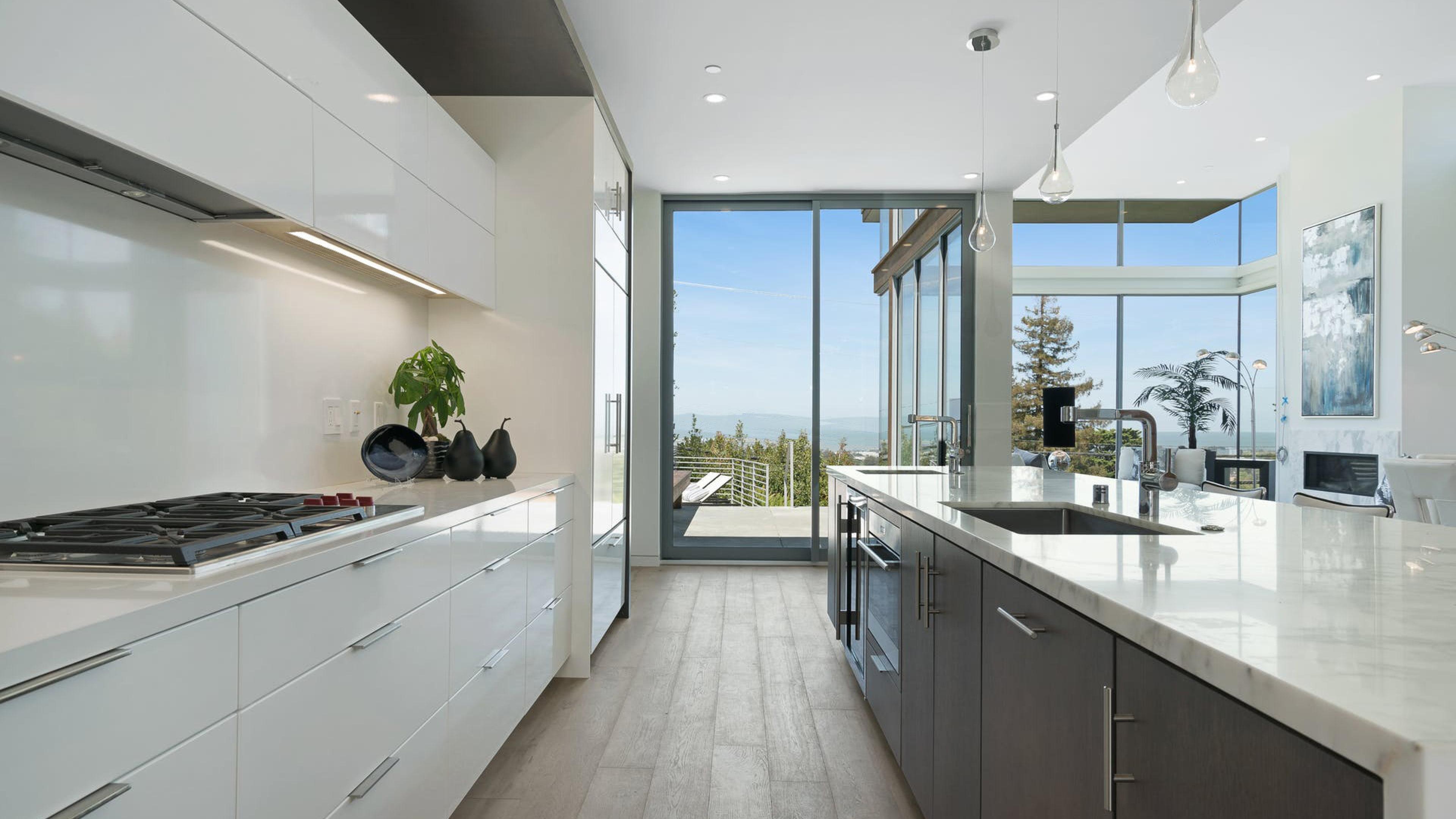 custom home minimalist kitchen floor to ceiling windows