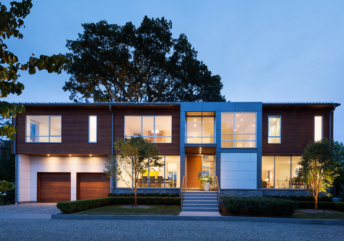 custom two-story home aluminum windows at dusk