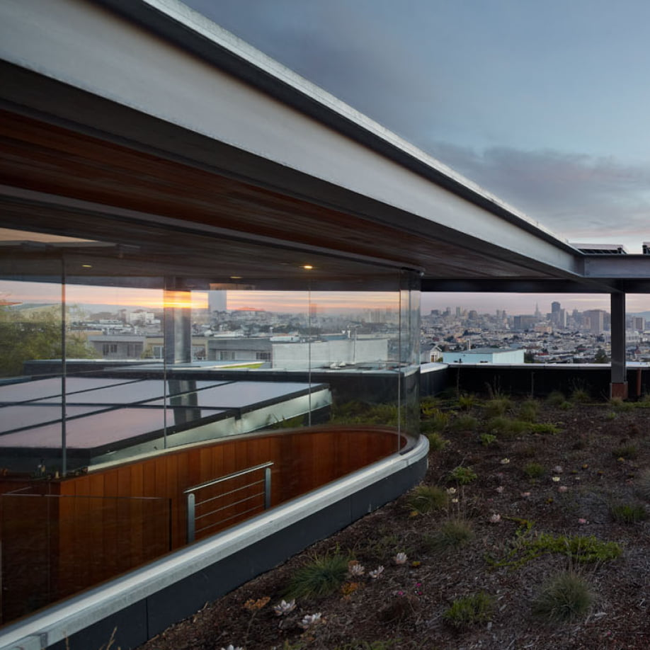 xiao yen home at dusk full window walls custom aluminum