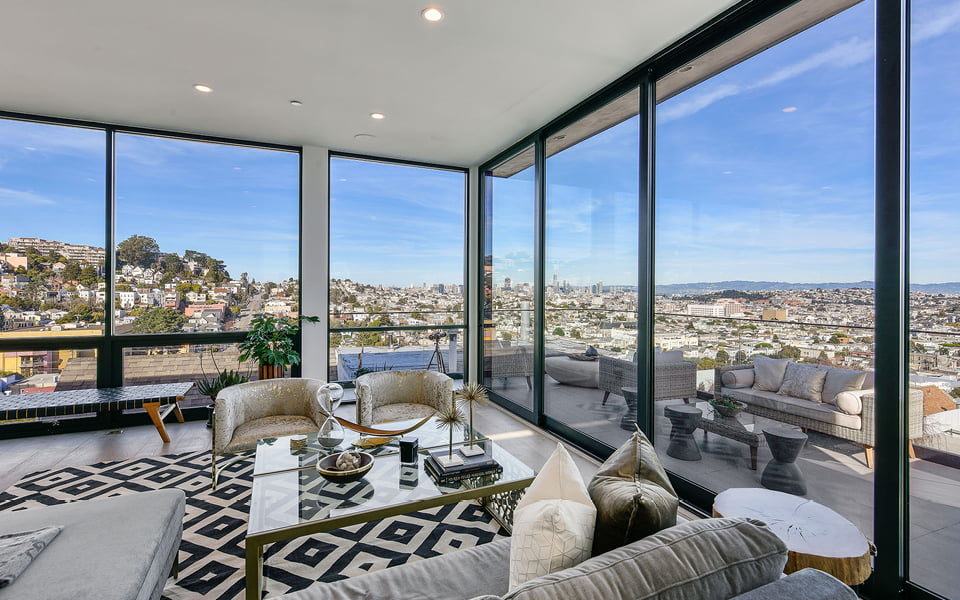 penthouse view surrounded by aluminum pocket doors