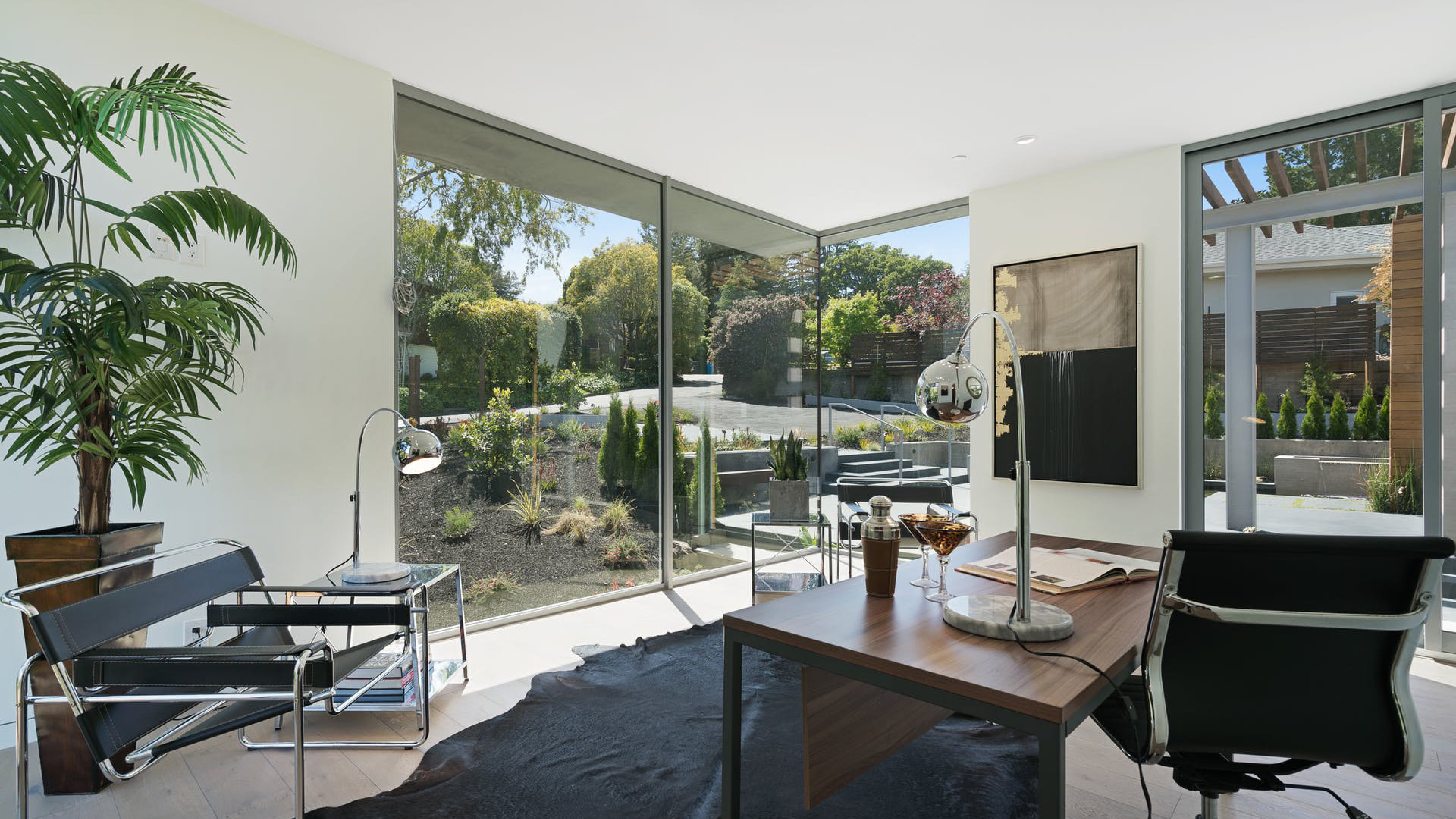 custom home office with floor to ceiling corner unit windows
