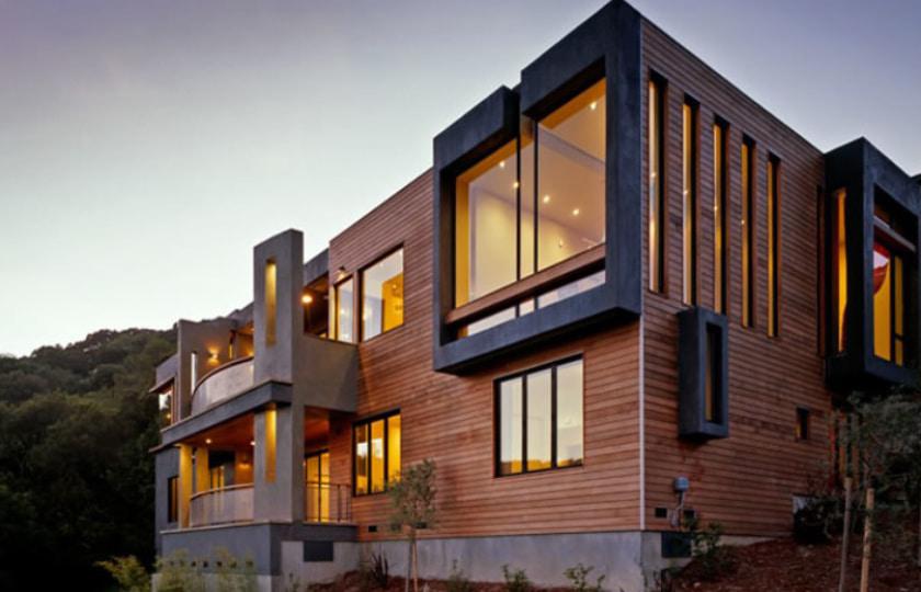 sleepy hollow home on a hillside extruded black trim around custom windows