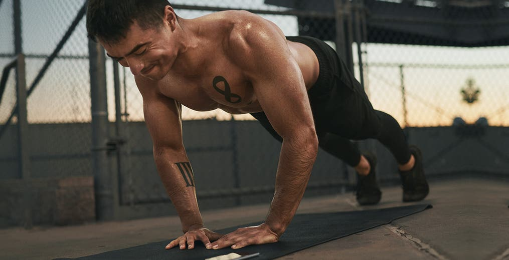 Male athlete performing Diamond Pushups