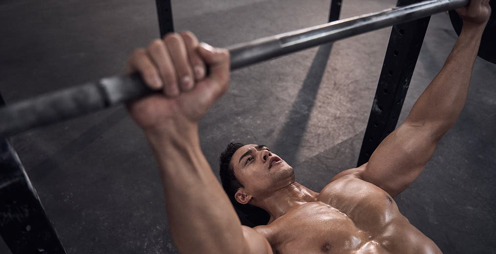 male athlete performing Bench Press