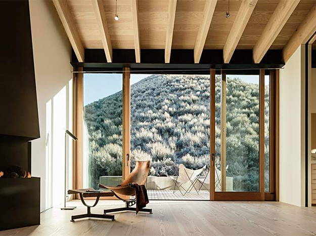 wood lift and slide door with a small mountain in the view