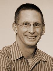 Sepia headshot of Tim Downing