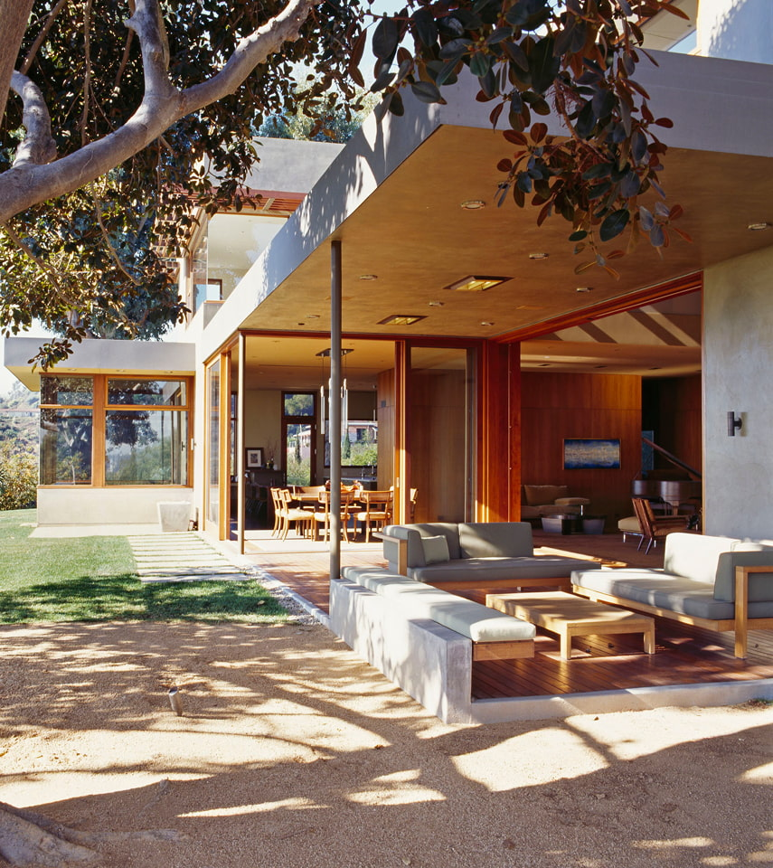 Exterior of home opened up to outdoor space