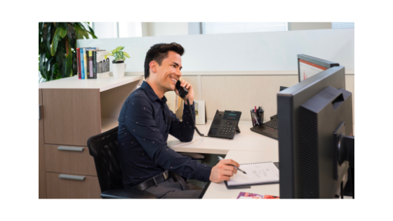 man on phone at office desk
