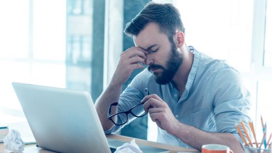 Frustrated man at computer