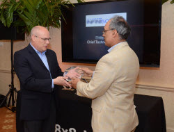 Bob Hughes, McLarens accepts award from 8x8 CEO Vik Verma.