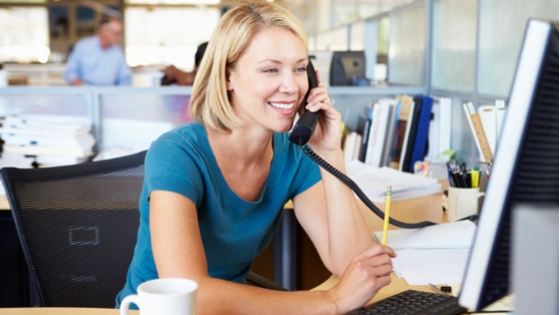 women on phone at office desk