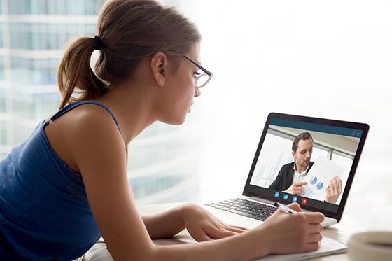Woman on conference call on laptop.