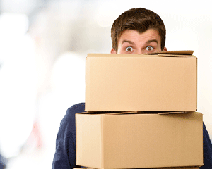 Business Phone Service: Man with moving boxes