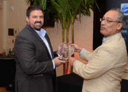 Tim McQuillen, Chief Knowledge Officer, Rubicon Project accepts award from 8x8 CEO Vik Verma