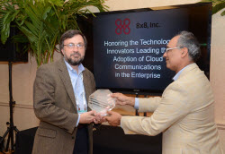 Craig Henne, CTO of Infinisource accepts award from 8x8 CEO Vik Verma