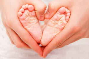 Business VoIP: baby feet in parent's hands