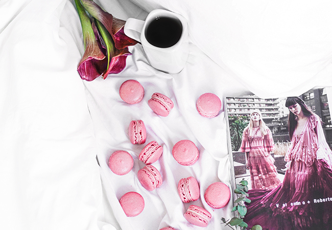 pink macaroons and coffee in bed as part of valentines day decor