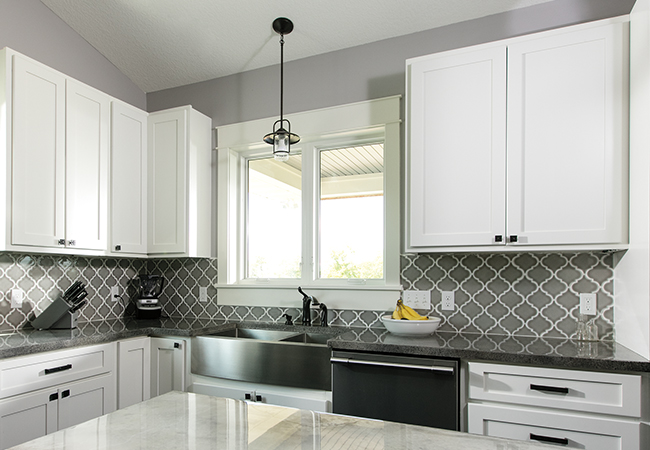 gray and white kitchen with matte black hardware