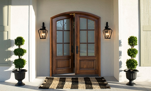 wood entry doors two panel arched with grilles