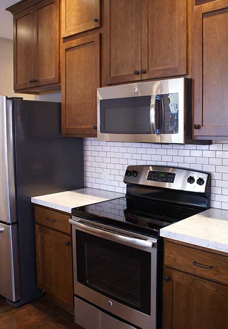 Updated stainless steel stove/oven and microwave with modern finished cabinets