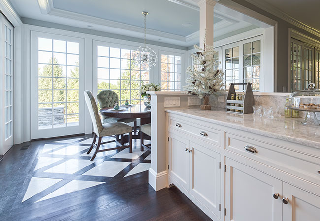 Large fixed windows bring a lot of light into the kitchen remodel in New York