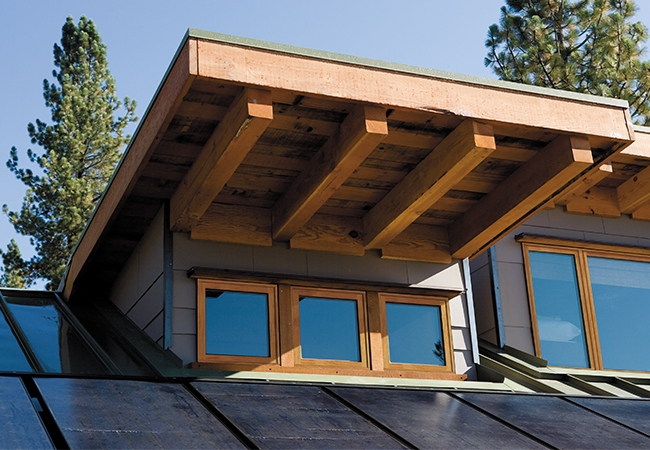 Small exterior wood windows underneath a square wood awning