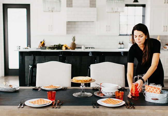 A woman setting a table for entertaining