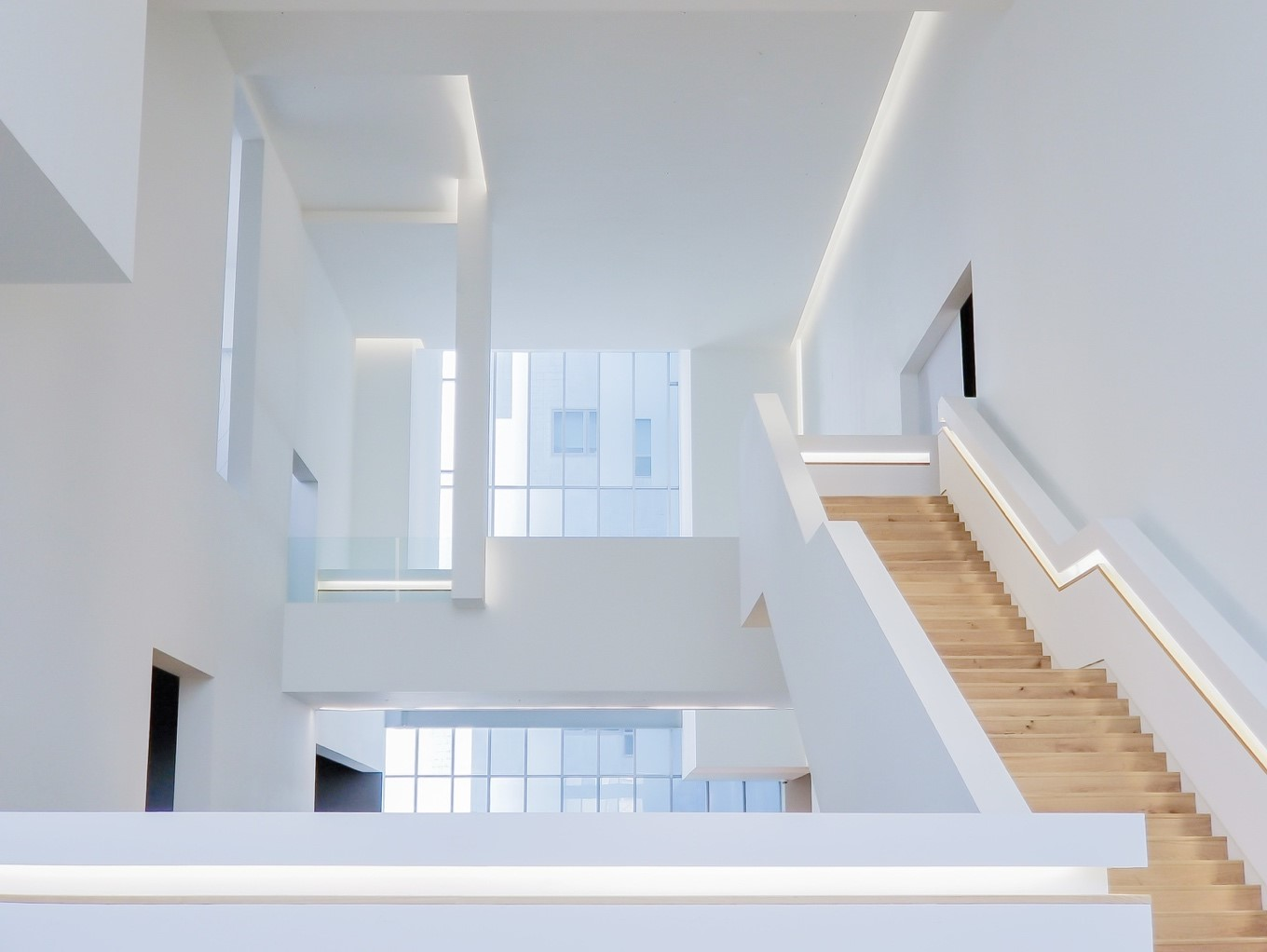 interior design trend staircase with LED lighting accents natural wood stairs white walls
