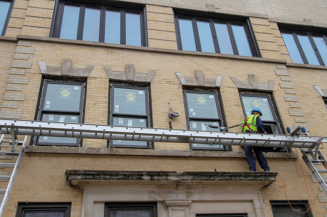 closeup view of new pella windows installed at 1032 waveland avenue chicago cubs wrigley field homerun resistant windows