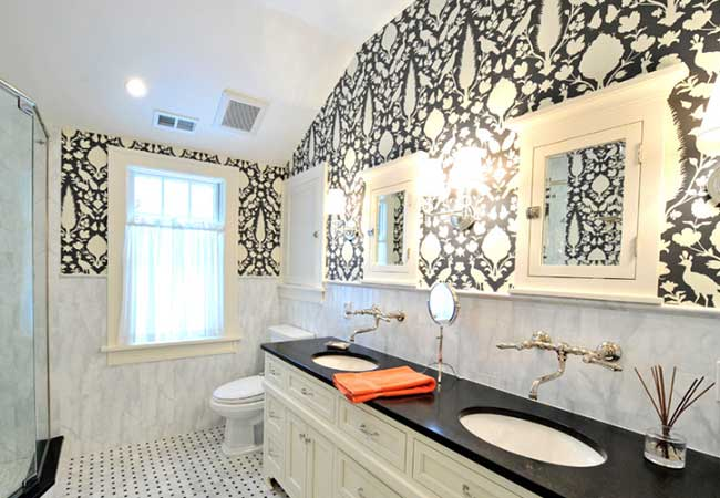 Unique, nature-inspired black and white design behind the bathroom vanity and window