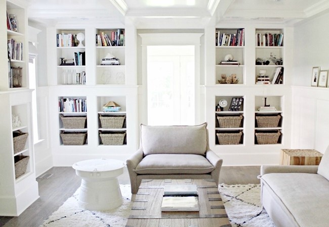 Simple designed living room with built-in bookshelves on both sides of a window designed by blogger The Leslie Style