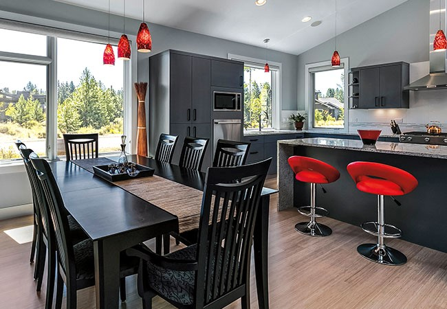 black dining table and red bar stools in modern kitchen