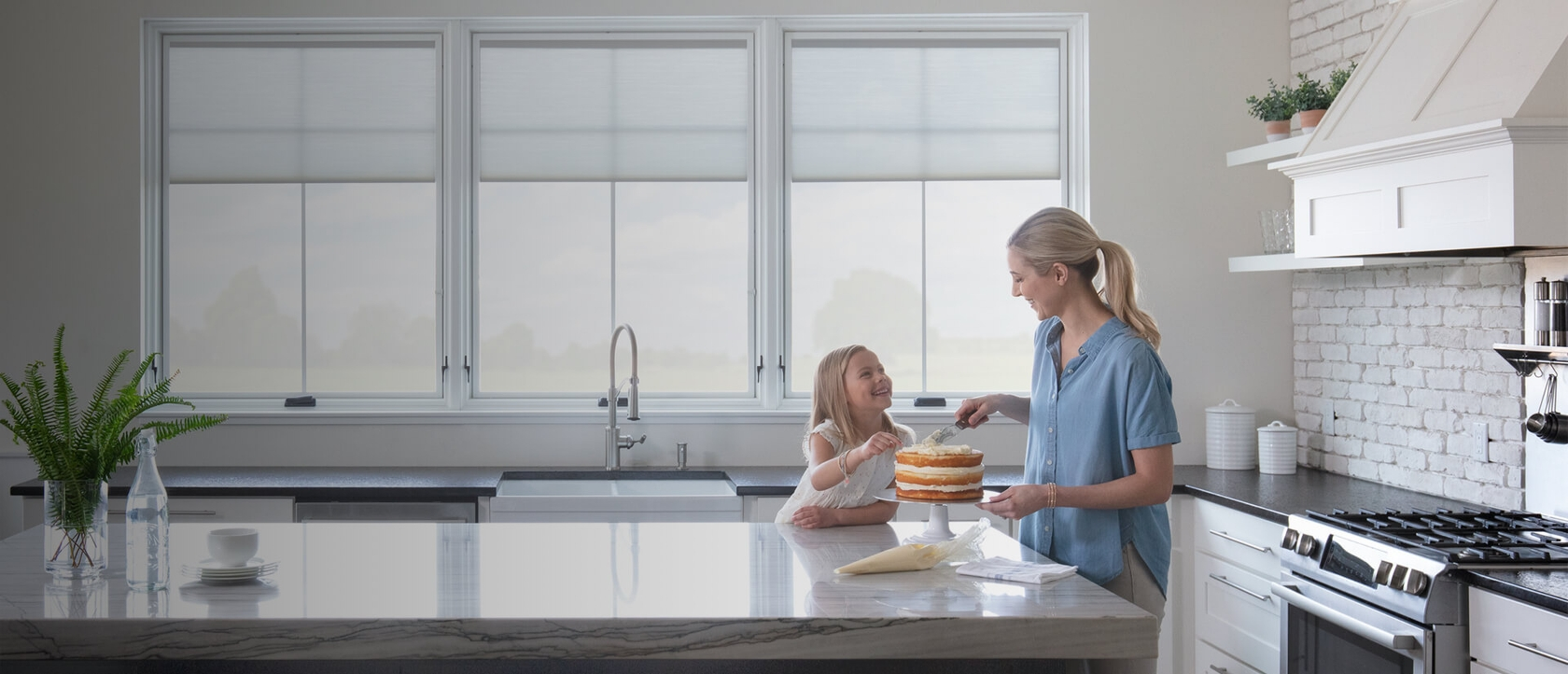 mother and daughter baking kitchen 3 large windows integrated blinds white trim Lifestyle Series
