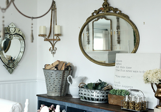 A white room with vintage decor by Tammy Damore and the blog A House in Bloom
