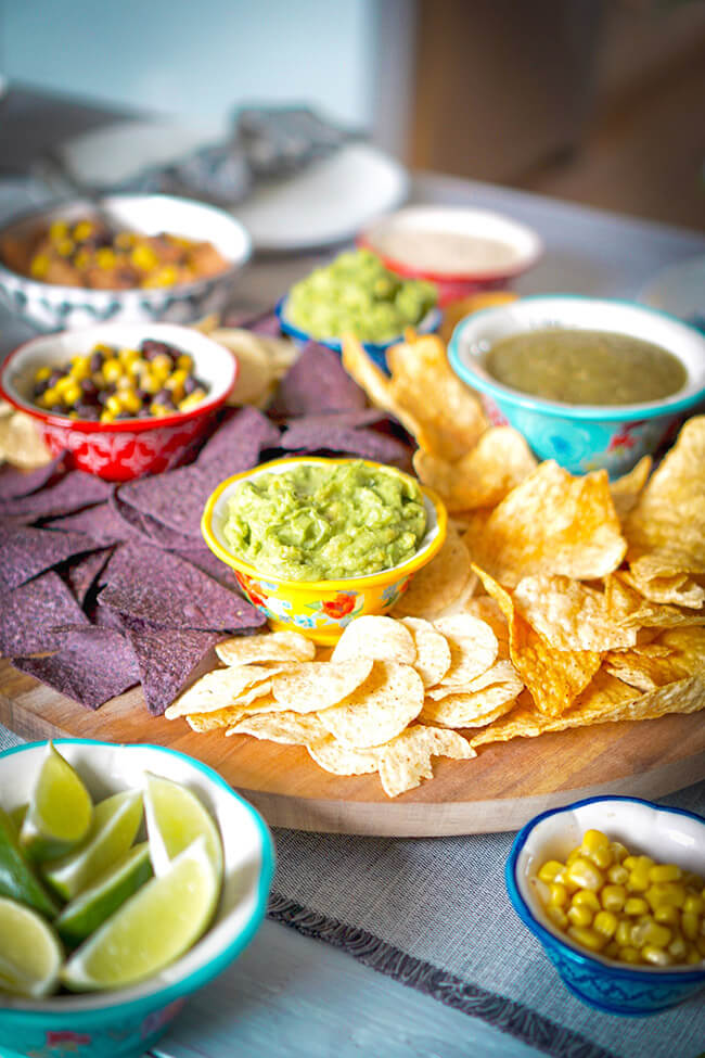 New years eve party chips and dips corn salsa guacamole green salsa
