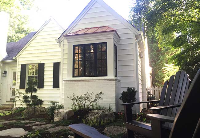 Backyard view of the exterior of a historic home with new historically accurate windows