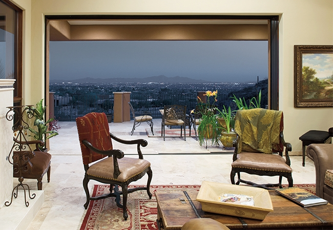 Formal living room opening up to a patio overlooking the mountains. Perfect setup for entertaining at home.