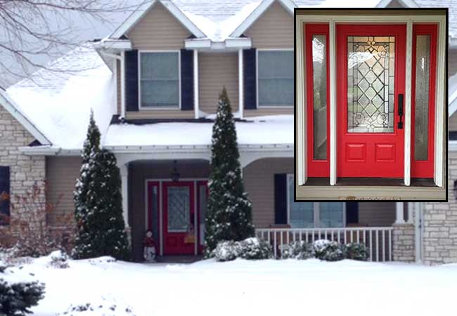 Exterior view of a bold entry door in Vivacious Red finish on a snowy day