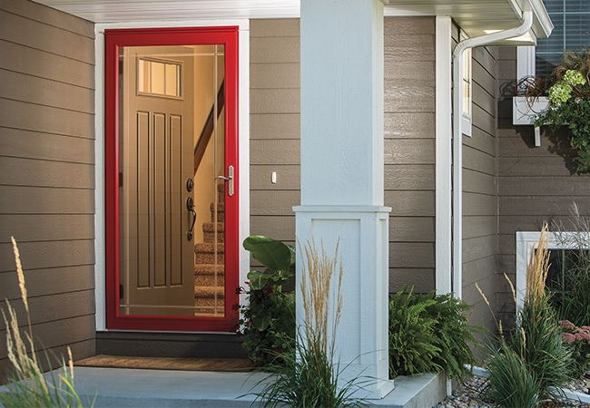 Warm front entrance featuring a red door