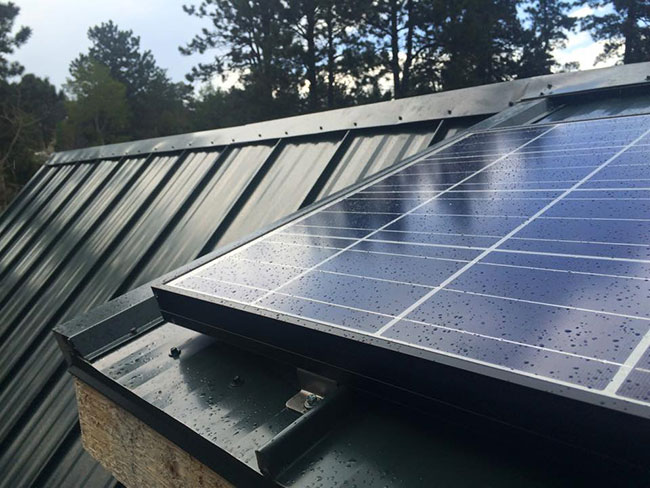 Close-up of the 140 watt solar panel on DIY tiny house roof